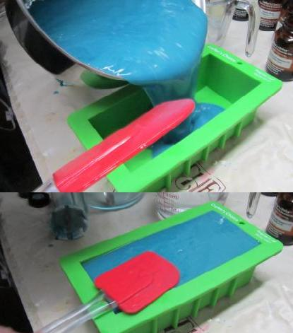 Pouring the traced soap recipe into silicone loaf molds, then smoothing down to make sure there are no air bubbles.